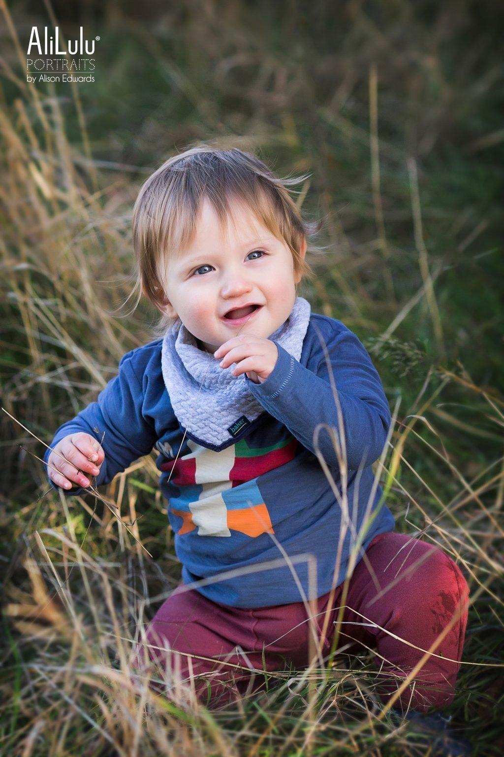 boy sitting in grass in autumn photos in Nottingham