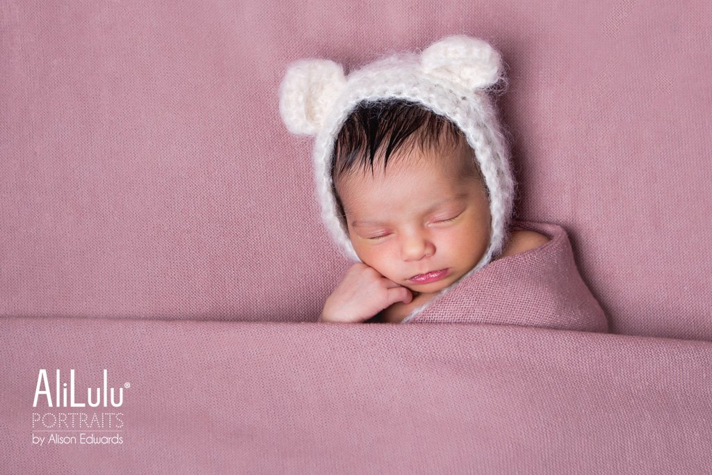 baby girl wearing teddy bear earshot beeston newborn photographer