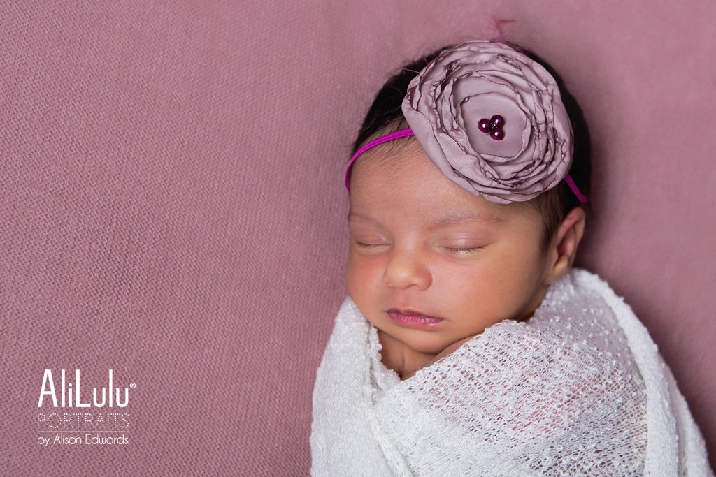 newborn baby girl with pink headband