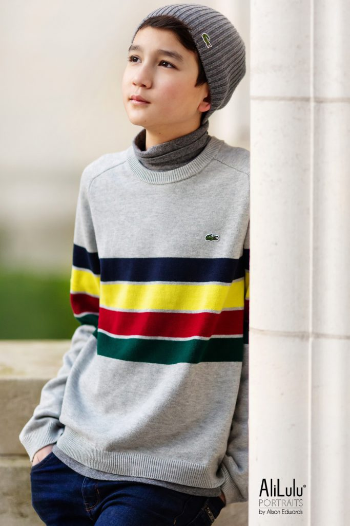 teenage boy portraits in lacoste jumper and hat