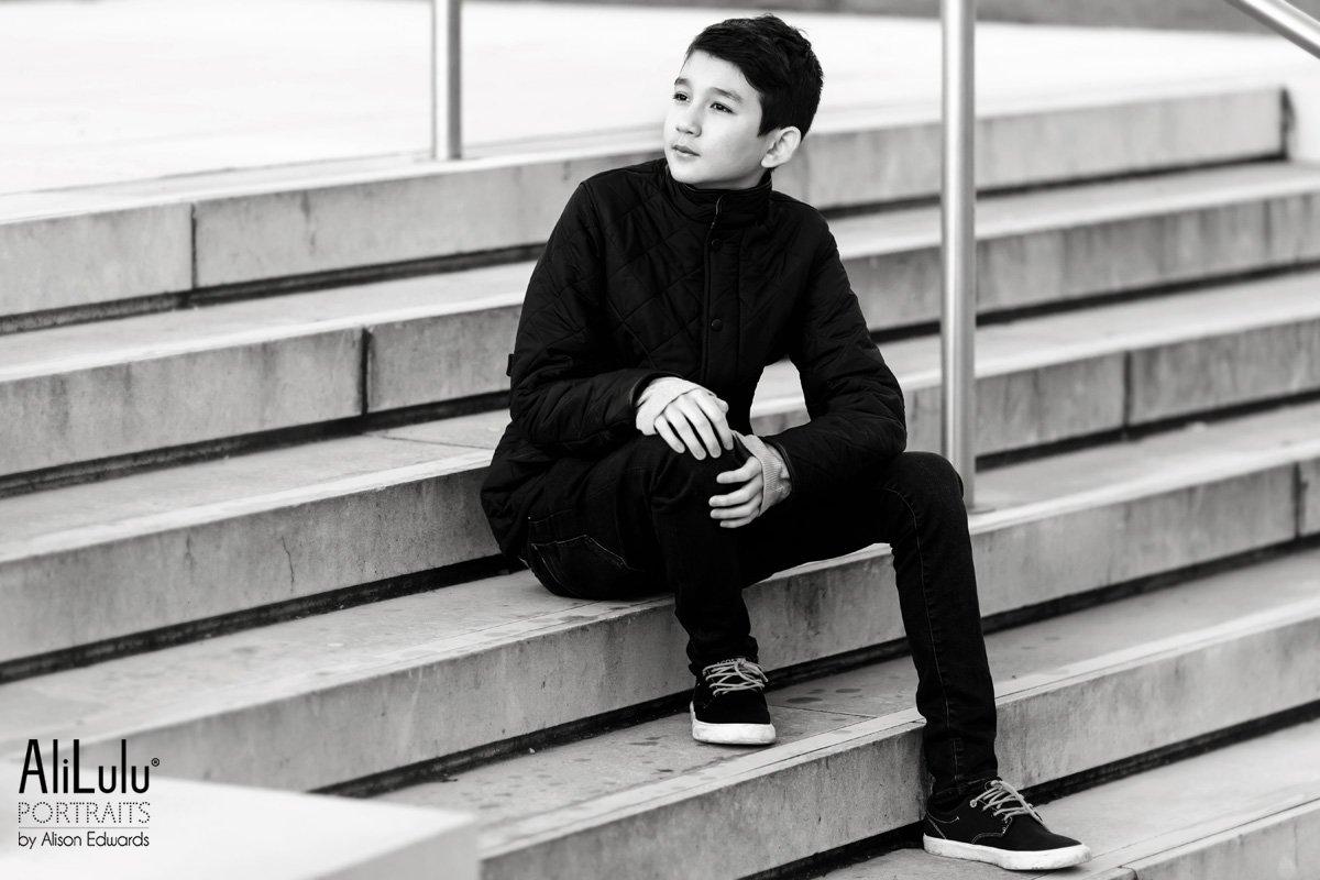 teenage boy portraits sitting on steps wearing barbour coat