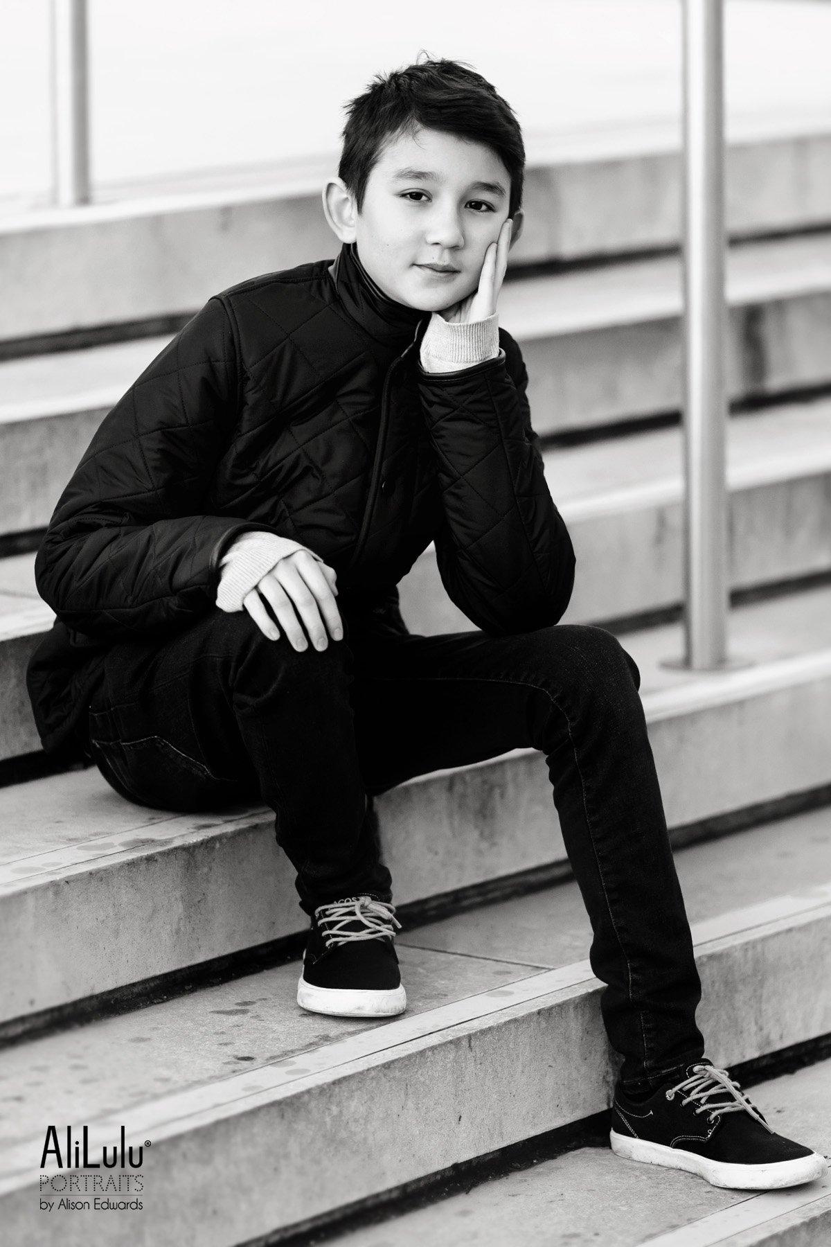 teenage boy sitting on steps on Nottingham
