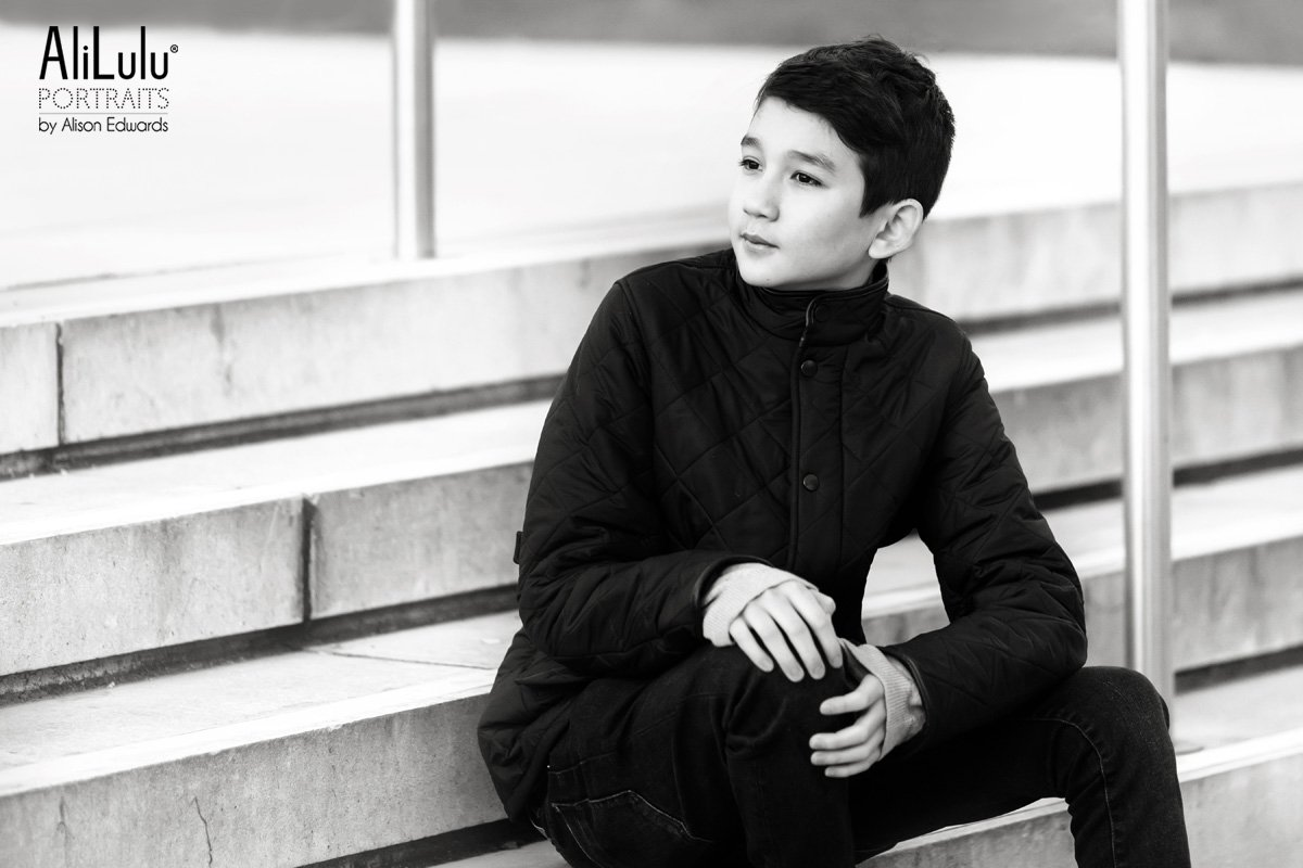 teenage boy sitting on steps in Nottingham