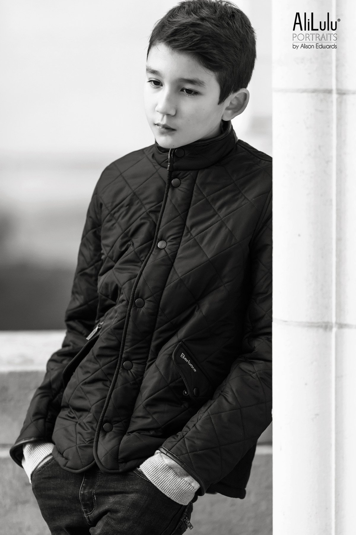boy looking thoughtful in barbour coat