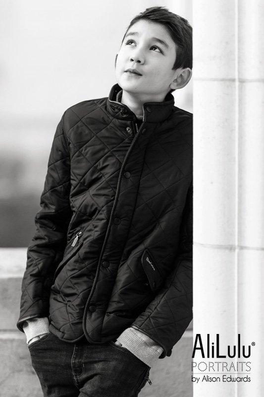 teenage boy smiling looking up in barbour cot