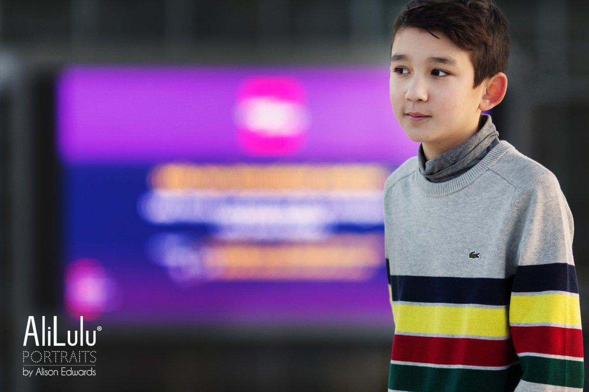 boy's portrait wearing Lacoste jumper