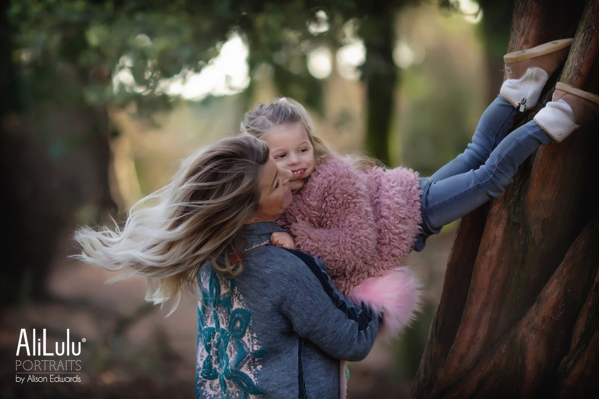 mum holding daughter in air on mummy and me photo