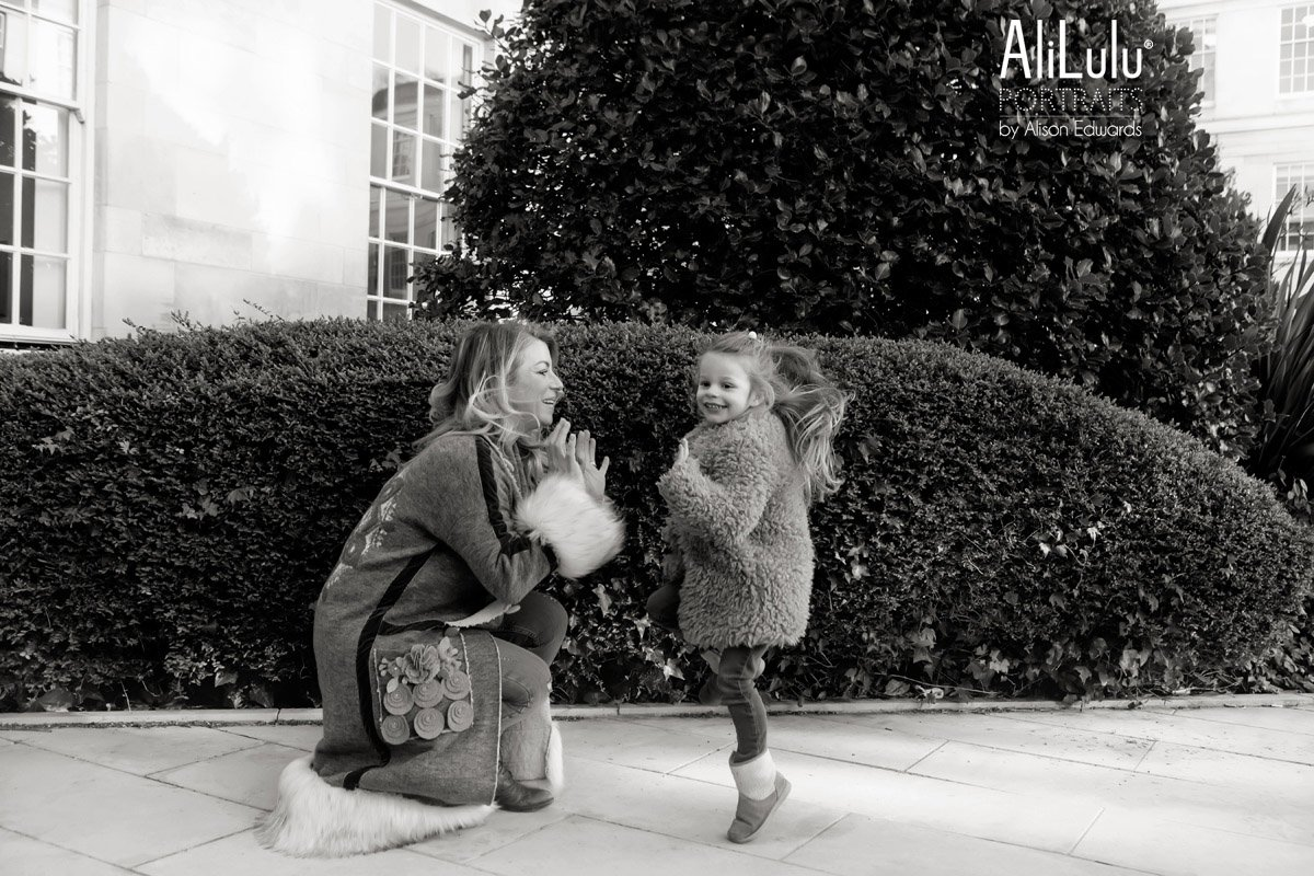 mum and daughter clapping