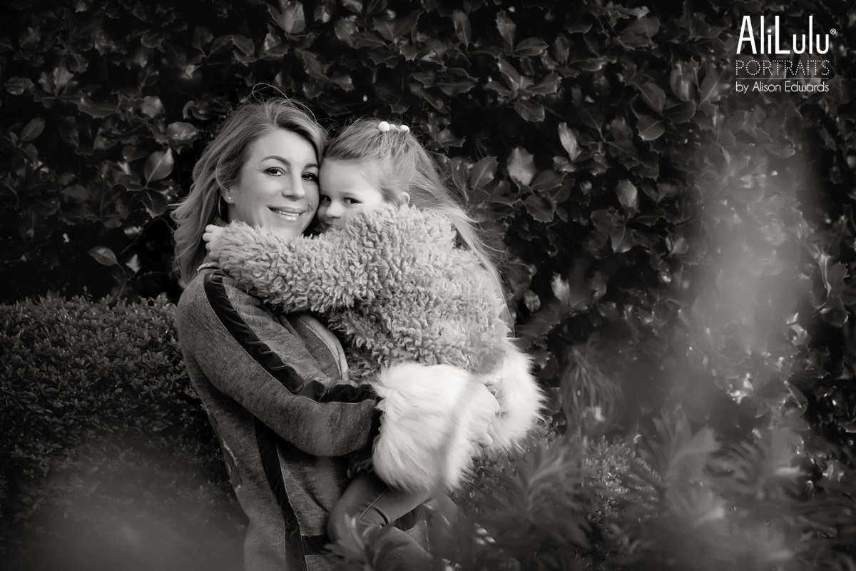 mum and daughter cuddling