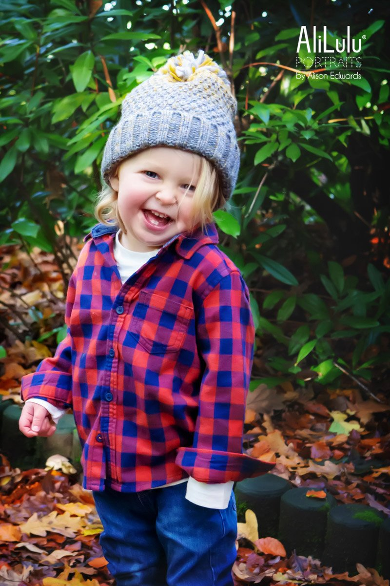 boy laughing wearing red checked shirt